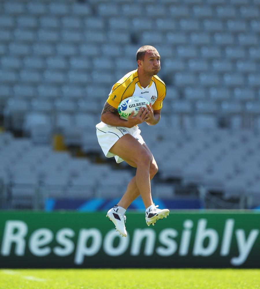 Australia's Quade Cooper takes a high ball during training