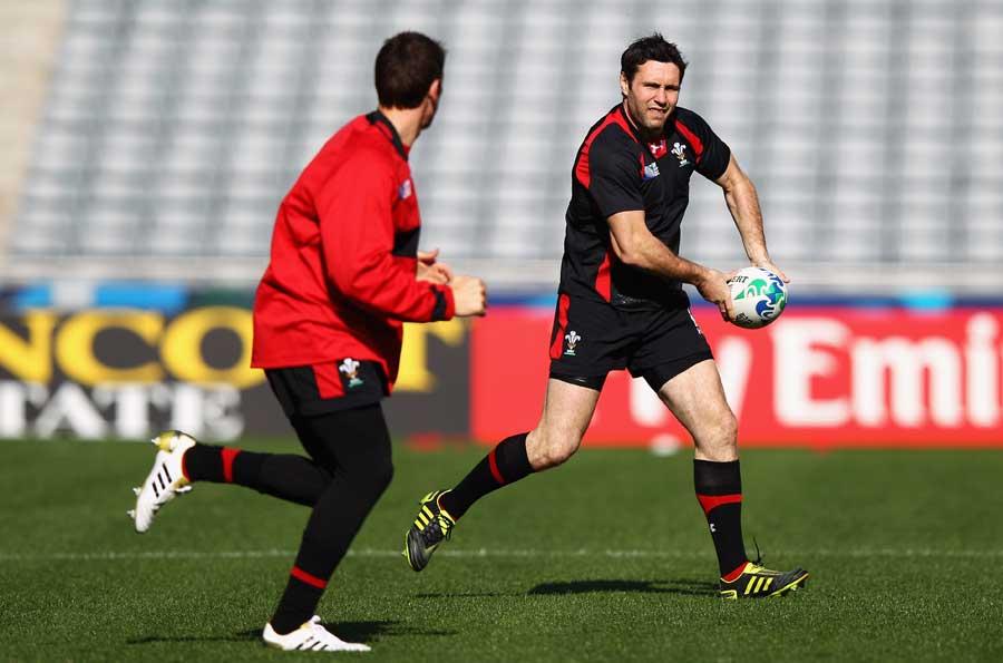 Wales fly-half Stephen Jones fires a pass inside