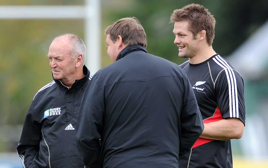All Blacks skipper Richie McCaw shares a joke with coaches Graham Henry and Steve Hansen