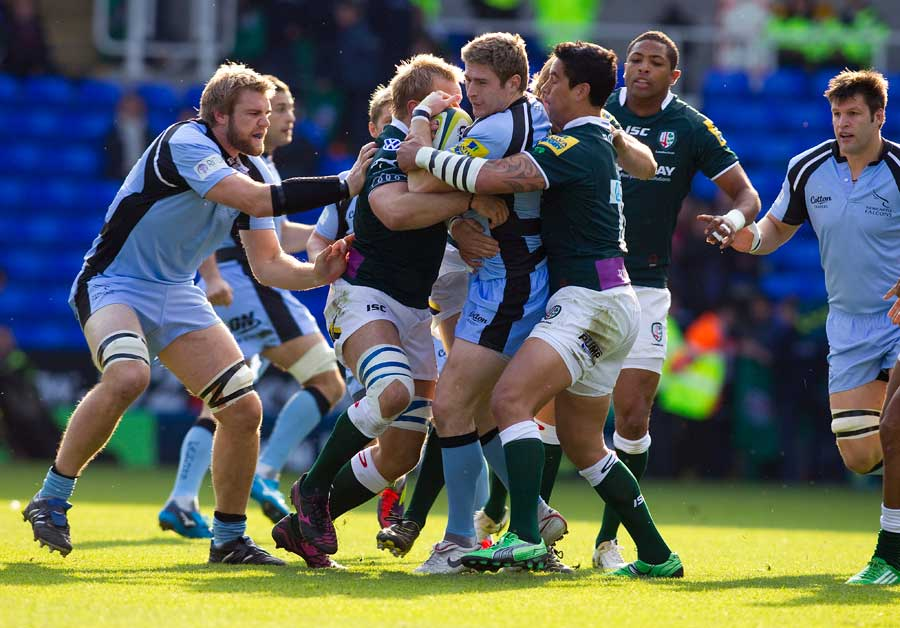 Newcastle's Luke Eves is wrapped up by the London Irish defence