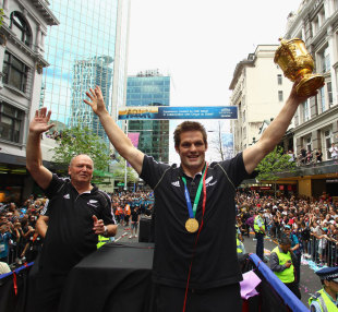 Richie McCaw and Graham Henry celebrate with the Webb Ellis Cup