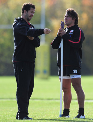 Saracens assistant coach Andy Farrell chats to hooker Schalk Brits
