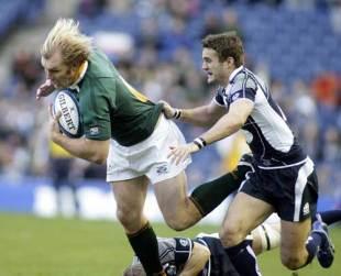 Springbok flanker Schalk Burger bursts through the Scotland defence at Murrayfield, November 15 2008