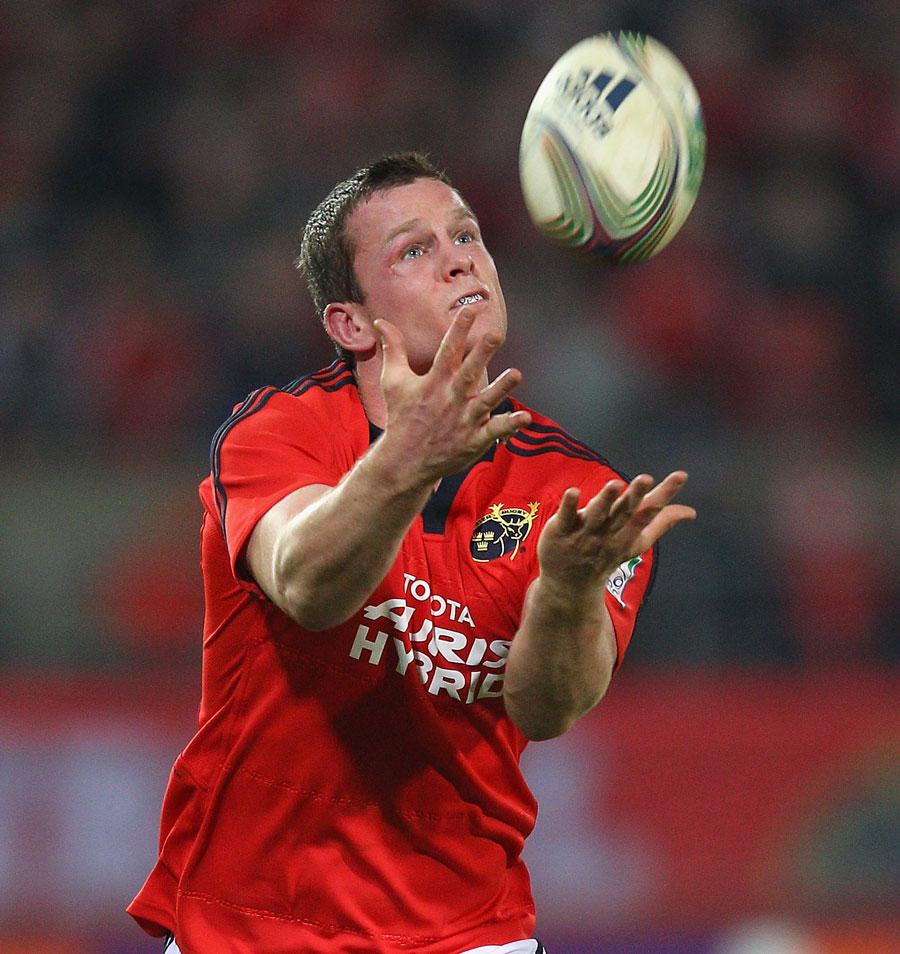 Munster fullback Denis Hurley fields a high ball