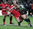 Northampton's Tom Wood tackles Saracens' Brad Barritt
