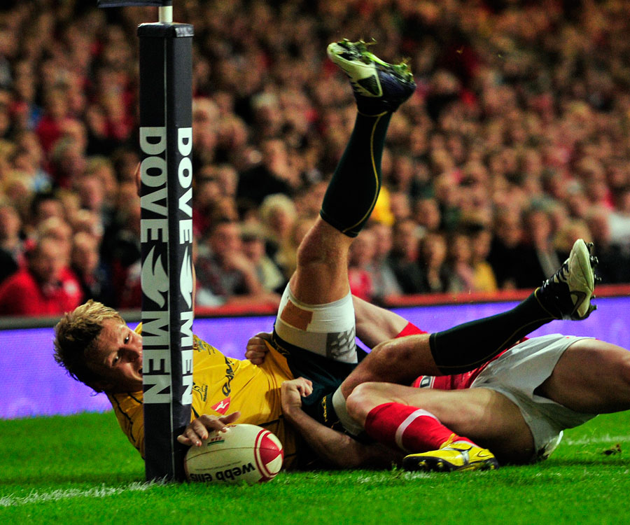 Australia's Lachie Turner tries to touch down in the corner