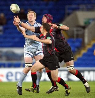 Edinburgh's Greig Laidlaw and Esteban Lozada compete with Cardiff Blues' Bradley Davies