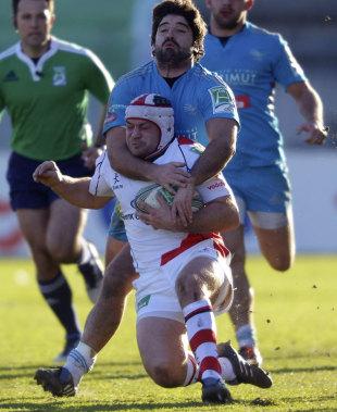Aironi's Gabriel Pizarro pulls down Ulster's John Afoa