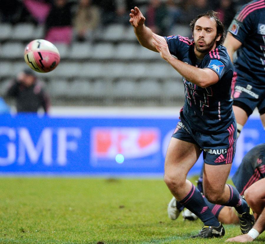 Stade Francais scrum-half Julien Dupuy fires off a pass