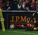 Gloucester wing Jonny May touches down