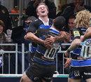 Bath's Michael Claassens celebrates scoring a try