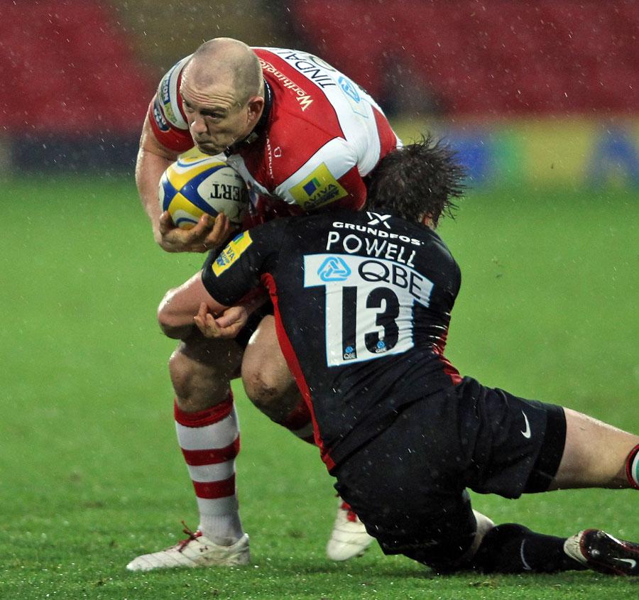 Saracens' Adam Powell tackles Gloucester's Milke Tindall