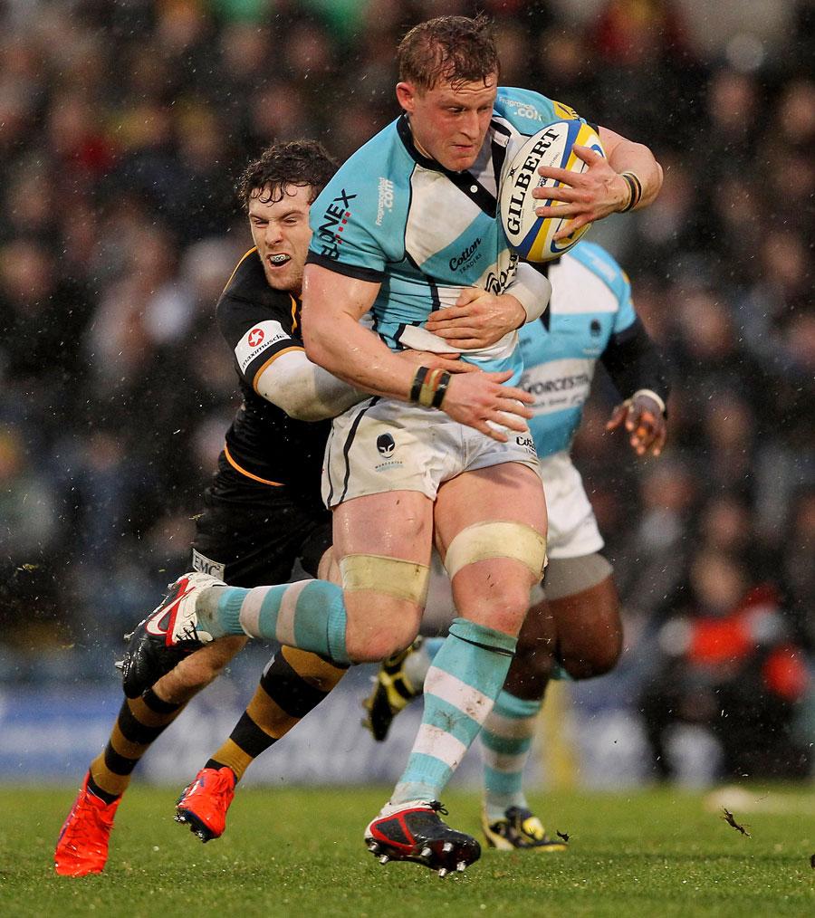 Wasps' Elliot Daly tackles Worcester's Jake Abbott