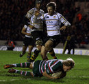 Leicester's Billy Twelvetrees crashes over to score
