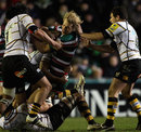 Leicester's Billy Twelvetrees is wrapped up by the Wasps defence