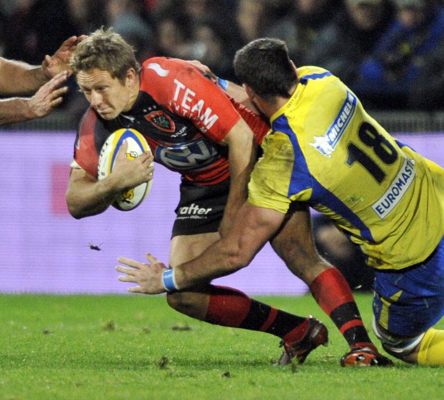 Toulon's Jonny Wilkinson is hauled down