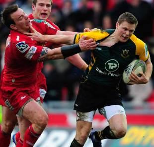 Northampton Saints' Chris Ashton pushes aside Matthew Rees