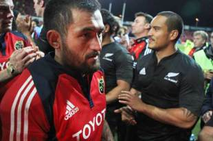 Rua Tipoki of Munster is clapped off the field by Hosea Gear (R) and other members of the All Blacks following the Munster v New Zealand All Blacks rugby match at Thomond Park in Limerick, Ireland on November 18, 2008.