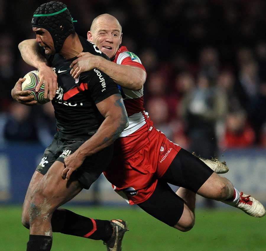 Gloucester's Mike Tindall clings on to Thierry Dusautoir