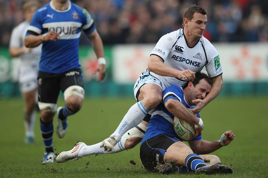 Bath's Matt Carraro is smothered by Glasgow's Colin Shaw