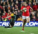 Munster's Simon Zebo evades Northampton's Ryan Lamb