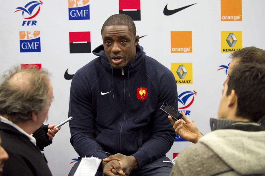 France flanker Yannick Nyanga talks to the media
