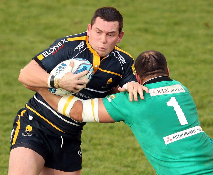 Worcester's Ed Shervington tries to break the tackle
