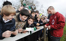 England boss Stuart Lancaster signs some autographs