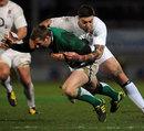 Irish Wolfhounds winger David Kearney is hit hard by Matt Banahan