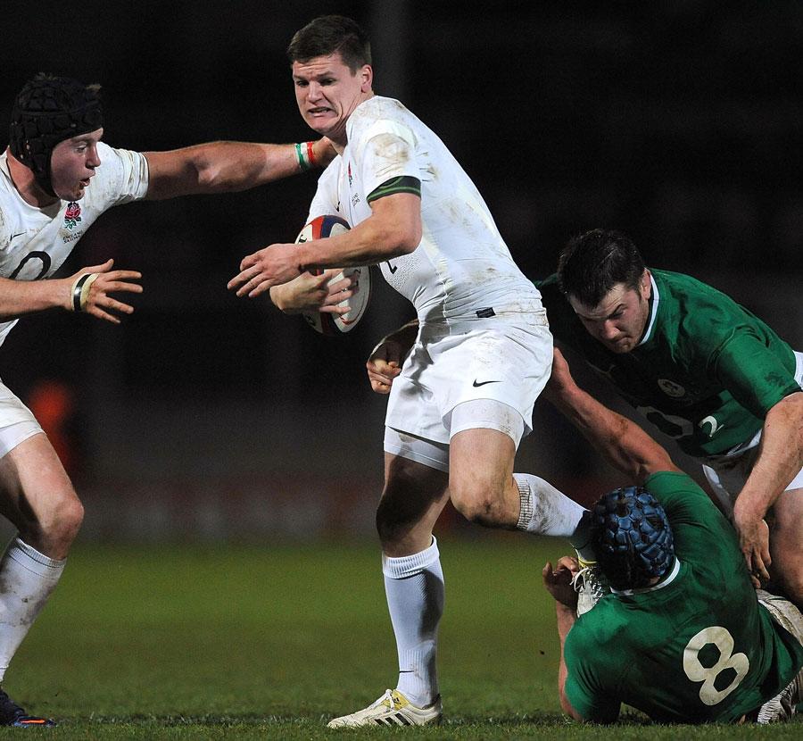England Saxons fly-half Freddie Burns wriggles away from Rhys Ruddock
