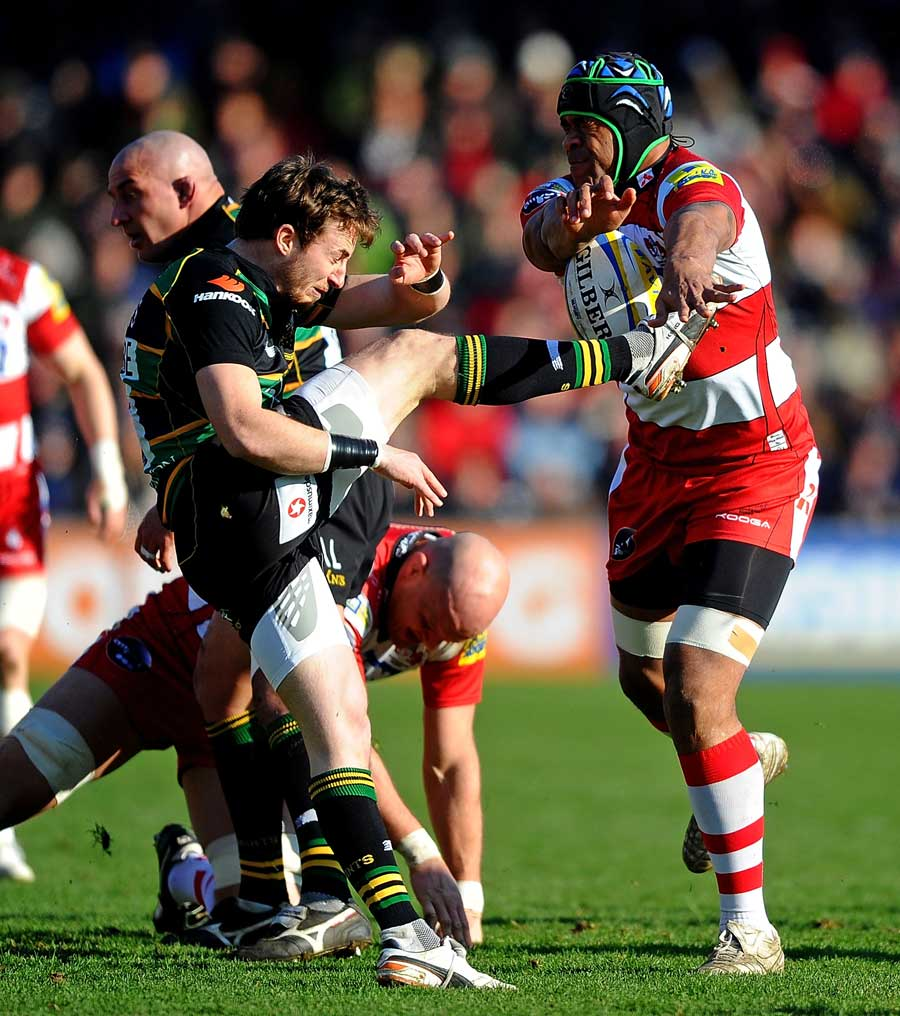 Northampton Saints scrum-half Martin Roberts has his kick charged down