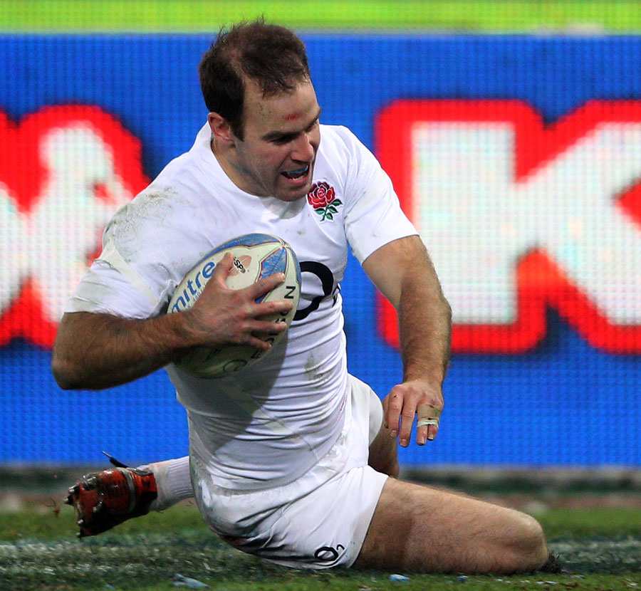 England fly-half Charlie Hodgson slides over