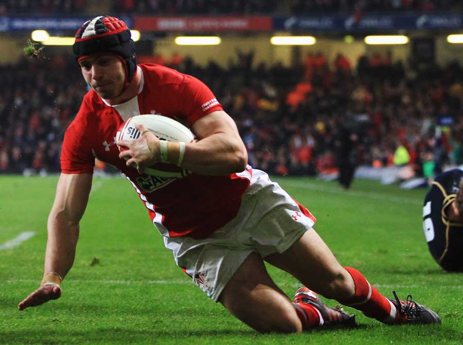 Wales' Leigh Halfpenny prepares to ground the ball