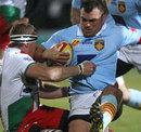 Biarritz's Imanol Harinordoquy pulls down Perpignan's Nicolas Mas