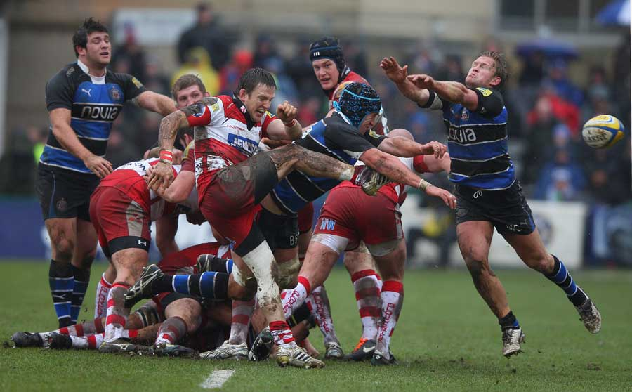 Gloucester scrum-half Rory Lawson's kick is charged down
