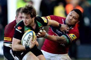 Northampton scrum-half Martin Roberts battles with Johnny Leota