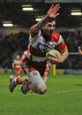 Gloucester's Jonny May salutes the crowd before scoring