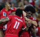 The Reds' Radike Samo celebrates his try