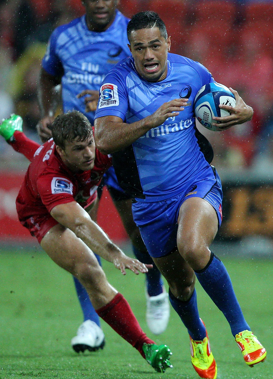 The Western Forces' Alfie Mafi bursts through the Reds defence