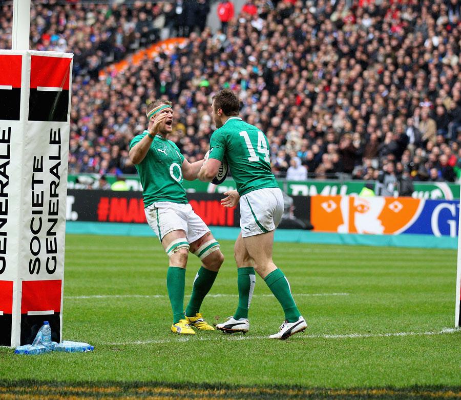 Ireland's Jamie Heaslip congratulates team-mate Tommy Bowe