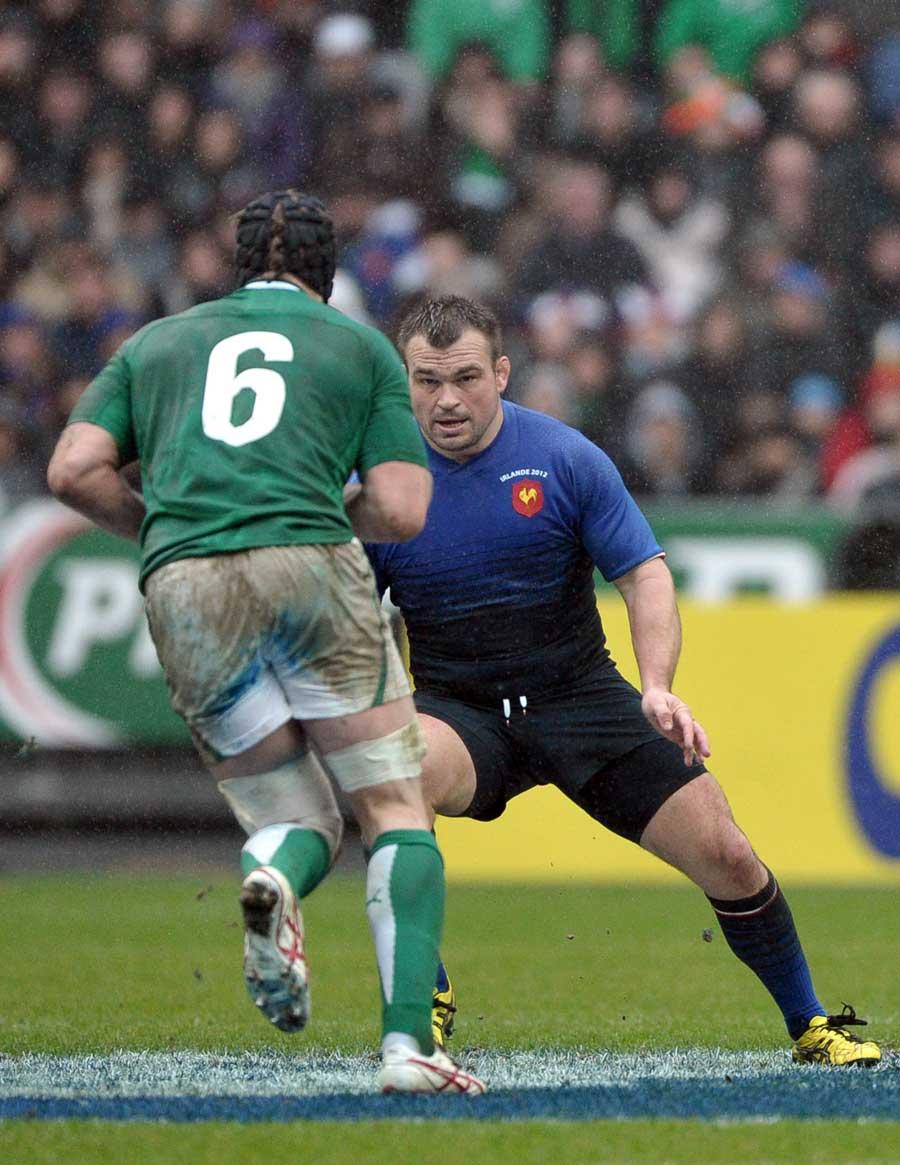 Ireland flanker Stephen Ferris takes on Nicolas Mas