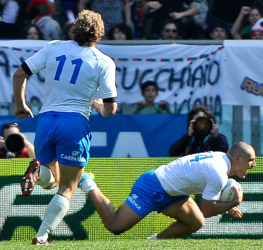 Italy's Giovanbattista Venditti goes over for the only score of the match
