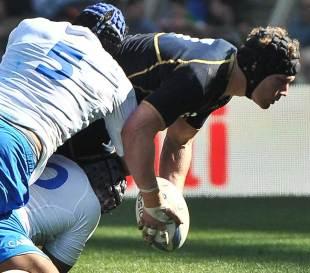 Ross Rennie looks to offload under pressure