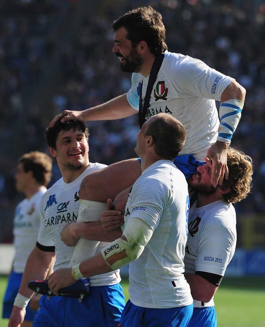Retiring hooker Fabio Ongaro is held aloft