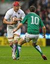 England's Mouritz Botha takes the attack to Ireland's Jonathan Sexton