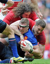 Wales' Ian Evans tackles France's Imanol Harinordoquy