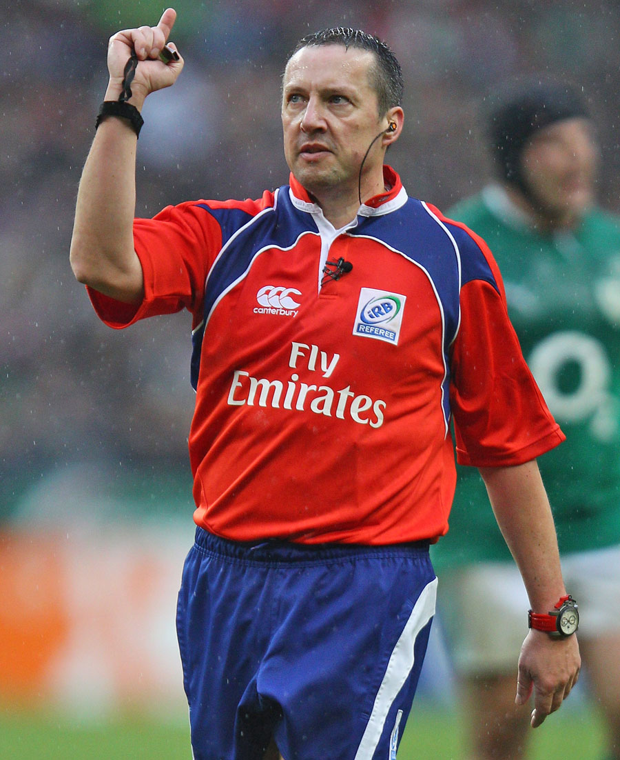 Referee Dave Pearson signals a decision