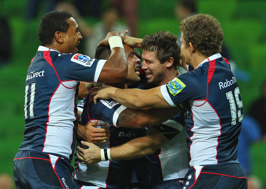 The Rebels' Lloyd Johansson is congratulated on a try