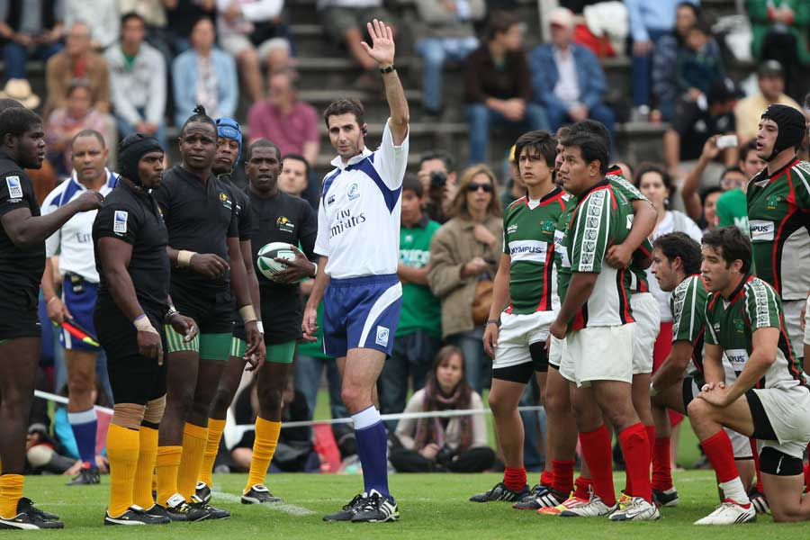 Referee Craig Joubert signals prior to a scrum