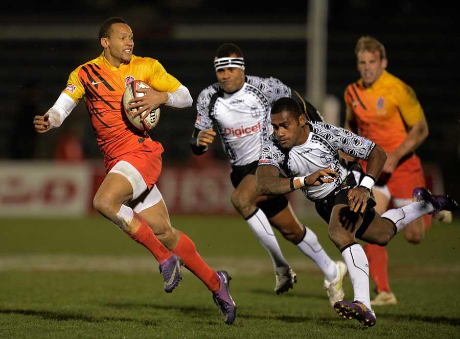 England's Dan Norton breaks clear of the Fiji defence